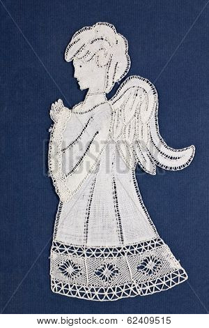 Antique angel embroidery on blue background