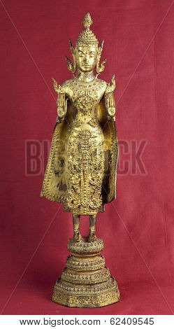 Hindu deity statuette on oxblood red background