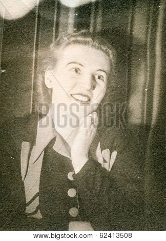 LODZ, POLAND, CIRCA 1940's: Vintage portrait of woman smiling