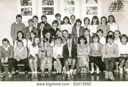 LODZ,POLAND, CIRCA 1970's: Vintage photo of group of  classmates posing together at school