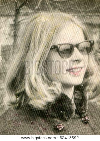 LODZ, POLAND, CIRCA 1960's: Vintage portrait of young woman