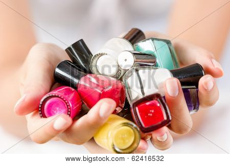 Close up of woman hands with nail polishes