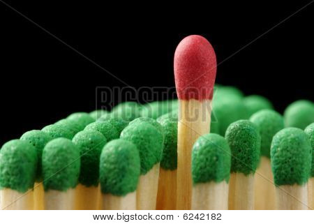 Single Red Matchstick Among Green Ones, Out Of The Crowd Concept