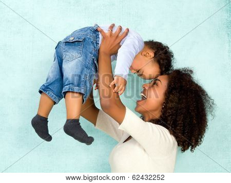 African mother playing with her 11 months old son