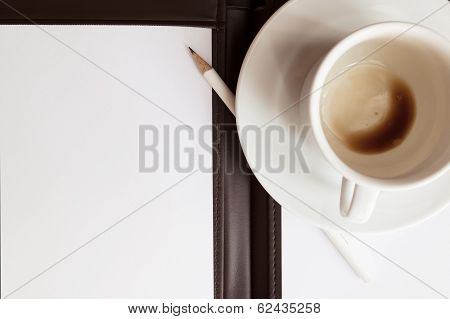Blank White Notebook, Pen And Cup Of Coffee