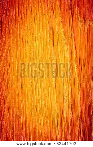 Closeup Of Wood. Orange Wooden Plank As Background Texture.