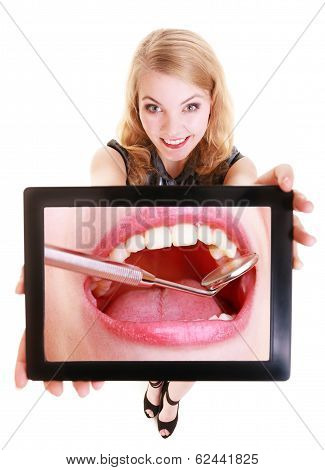 Girl Showing White Teeth On Tablet. Dental Care.