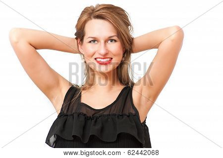 a beautiful woman posing and smiling coquettishly