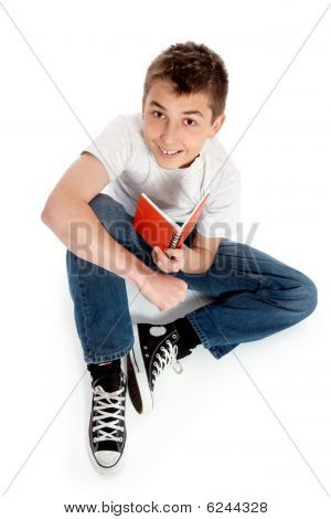 Pre Teen Boy Sitting With A Book