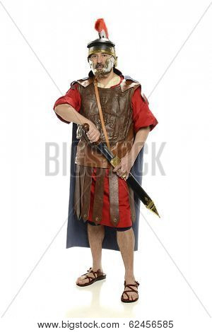 Roman soldier with sword standing up isolated on a white background