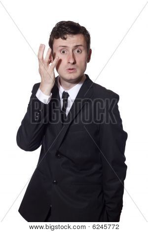 Baffled Businessman Scratching His Head