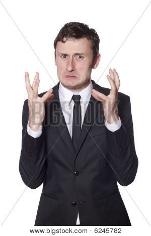 Angry Businessman In A Black Suit