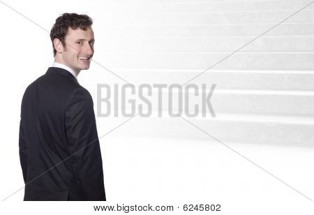 Smiling Businessman, In The Background The Steps To Sucess
