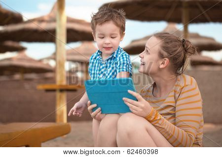 Little boy with is mother at a beach resort