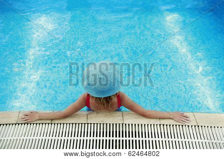 Girl In A Hat In The Water Pool