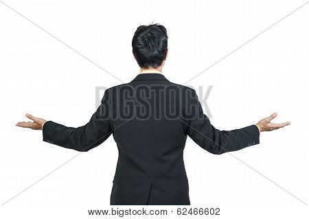 Back View Of Businessman Behind And Presenting  On White Background