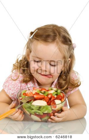 Little Girl About To Taste The Fruit Salad