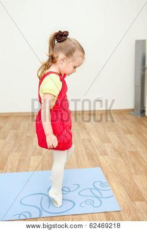 Little Girl Walking On Tiptoe Over Sports Mat