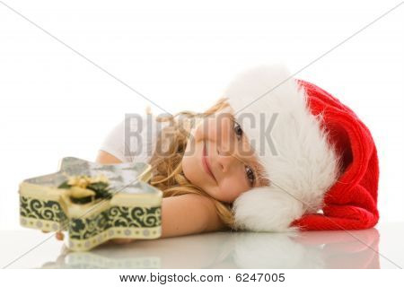 Girl Leaning On The Table With Christmas Cookies Box