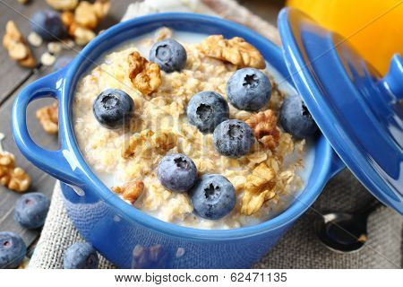 Oatmeal With Fresh Blueberries Over A Rustic Wooden Background