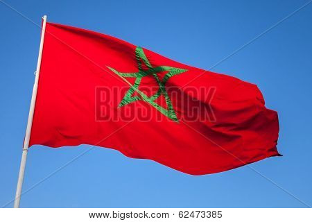 National Flag Of Morocco On A Flagpole Above Clear Blue Sky