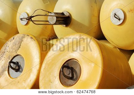 Stack Of Yellow Buoys In A Port