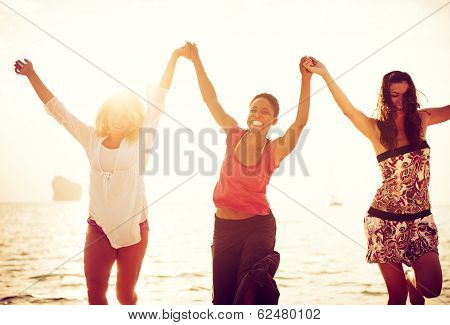 Women Dancing On Beach