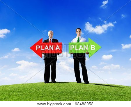 Two Businessmen Holding Arrows for Plan A and Plan B