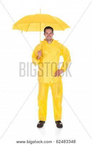 Mature Man Wearing Raincoat And Holding Umbrella Over White Background