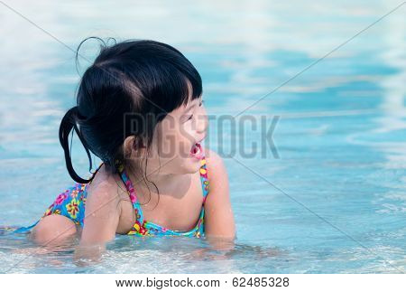 Happy Kid Playing In The Water