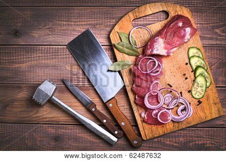 Sliced raw meat pork on board