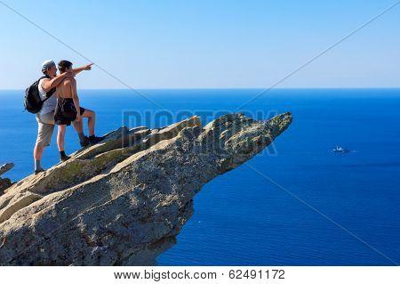 Father On A Mountaintop Shows Son Ship Far Out At Sea