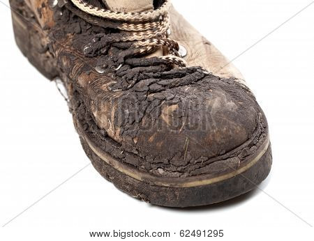 Part Of an Old Dirty Hiking Boot On White Background