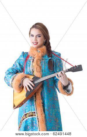 Charming Russian girl playing balalaika in studio