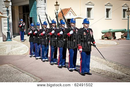 MONACO - MARCH 23,2014: The military force performing the Change of Guard, March 23, 2014 in Monaco. The event happens daily at the Place du Palais at 11:55am