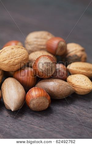 Heap Of Nuts On A Wooden Surface