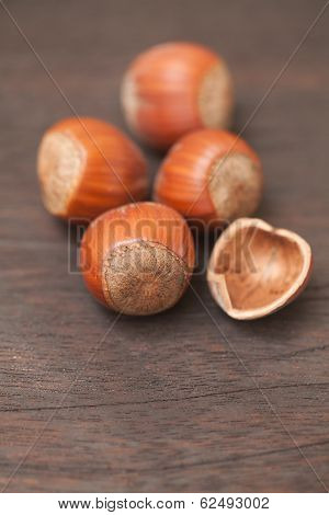 Heap Of Hazelnuts On A Wooden Surface