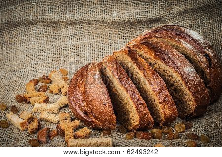Still-life with loaf of bread, raisins, hard chuck