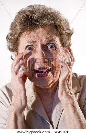 Senior woman with frightened look on her face