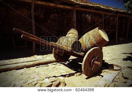 Antique Wagon With Barrels In The Castle Castelo De Castro Marim In Portugal.