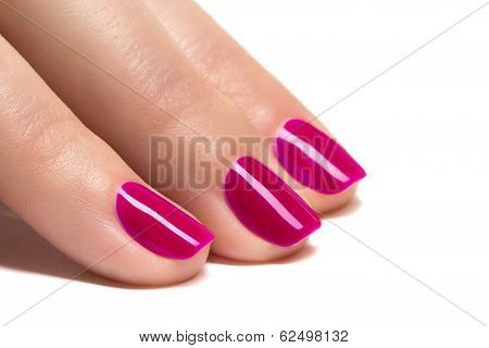 Woman hands with manicured pink nails closeup. Skin and nail care.