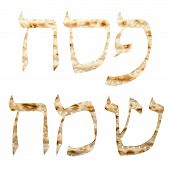 stock photo of hebrew  - Hebrew text Happy Passover written in Matzo - JPG