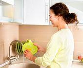 image of dishwasher  - Woman Washing Dishes - JPG