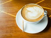 pic of latte  - latte coffee on wood table in coffee shop - JPG