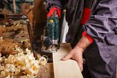 stock photo of joinery  - The carpenter hands when working with electric planer joinery
