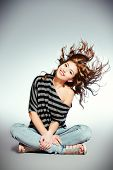 foto of hair motion  - Beautiful smiling girl with fresh pure skin and beautiful hair in motion - JPG
