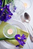foto of purple iris  - Festive table setting with purple iris flowers vintage cutlery and candles - JPG