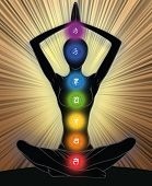foto of kundalini  - Woman silhouette in yoga position with the symbols of seven chakras - JPG