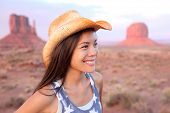 picture of cowgirl  - Cowgirl woman happy portrait in Monument Valley wearing cowboy hat - JPG