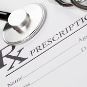 Medical ideas - blank prescription and stethoscope above it - 1 to 1 ratio